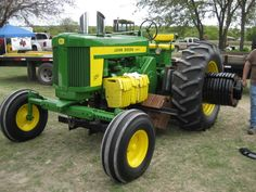 John Deere 2 cylinder model 720 weighted for pulling with the big boys