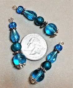BF-293; Three Drops of Eye Catching Turquoise Smooth and Faceted Glass with Silver Findings Turquoise Glass, Upcycled Crafts, Faceted Glass, Craft Items, Silver Beads, Third, Smooth, Beaded Bracelets, Drop Earrings