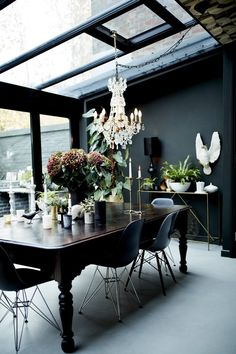 Extraordinary Interiors by Jane Rockett & Lucy St George, Home Accessories, dining space with glass ceiling, chandelier, vintage table paired with Eames chairs. Home Interior Design, Interior And Exterior, Interior Decorating, Decorating Kitchen, Interior Designing, Kitchen Interior, Kitchen Decor, Conservatory Dining Room, Sala Vintage