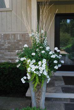 Angelonia, trailing white verbena, petunias (all heat loving and drought resistant) + creeping jenny. Deborah Silver, landscape and garden designer.