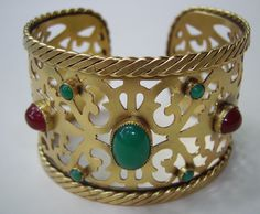 Vintage YSL pierced metal cuff bracelet with red and green faux cabochon