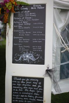 In place of wedding programs for my daughter's wedding, I used an old door with chalkboard paint, leaning against the tent entrance.