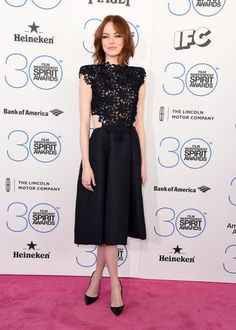 The day before the Oscars, Emma Stone looked breezy and effortless in a Monique Lhuillier design that walked the Fall '15 runway just eight days before. Emma let the intricate detail of this number speak for itself, namely how the lace bodice crosses over onto the full jacquard skirt, creating a cutout effect. Source: Getty / Steve Granitz