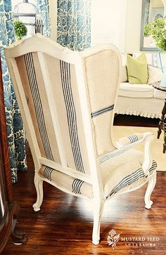 gracious. wing backed chair covered in old grain sacks. must have one or two!