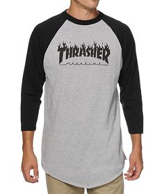 Get a classic two tone style with a Thrasher flame logo graphic at the chest of a grey body with contrasting black 3/4 length raglan sleeves.