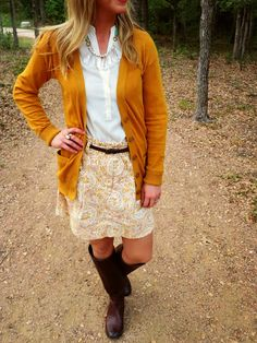 This Fall make a statement with great prints! Love this amazing skirt paired with chic leather boots and long cardigan. #FallFashion