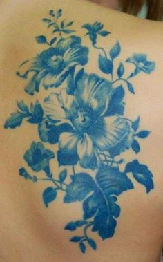 Antique blue floral tattoo.... I love the way this looks!