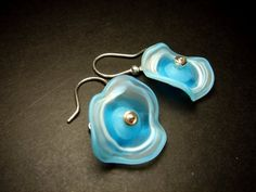 Designer Earrings Blue Fused Glass and Sterling Silver by Jan Art Israel. Elegant drop earrings handmade by jewellery designer Jana Sobelmann of JanArt. Each earring is sterling silver and features a large glass floral stone in pale blue.