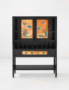 DR. CHRISTOPHER DRESSER display cabinet, circa 1880 Ebonized wood, copper with inset cloisonné enamel. 65 3/4 x 47 7/8 x 14 3/4 in. (167 x 121.6 x 37.5 cm)