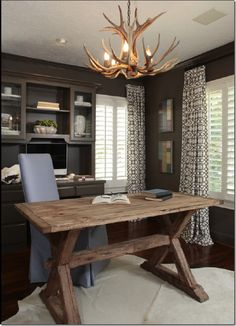 This is the perfect marriage of my husbands style and mine. (The antlers and rustic wood = His // The skirted chair and trellis print drapes = Hers)