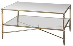 Enjoy our Nicolina Coffee Table as the crowning jewel to your living room. It's classy, feminine, reflective and delicate with the mirrored top, glass storage shelf, and gold leaf finish.