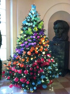 Tree with multicolored ornaments in diagonal stripes