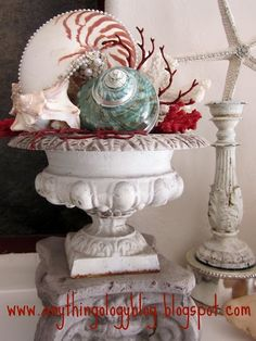 Fabulous!  Love the red coral in the urn and the beads on the shells.  Gorj!