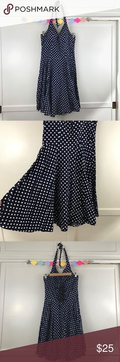 "Dark Blue Polkadot Halter Dress Dark Blue Polkadot Halter Dress. A pretty retro style dress with swirling full circle skirt. Corset style lace up details on the back. Size Large. 100% Cotton.  Chest: 39"" Waist :32"" Hips:Open Length:36"" Dresses Midi"