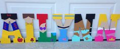 Disney Princess Inspired Hand Painted Wooden Letters by PeasNCarrotsShop on Etsy https://www.etsy.com/listing/246133336/disney-princess-inspired-hand-painted