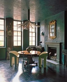 For the British designer, a private home in London's Mayfair became a chance to reinvent the idea of Englishness with an inky palette, and a unique room spray redolent of leather and mud.
