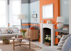 This pale duck-egg blue, toned with dark grey, creates a cocooning effect. Keep a bright and modern feel with a feature wall and horizontal band in muted orange. Featuring Moroccan Flame and Urban Obsession by Dulux.