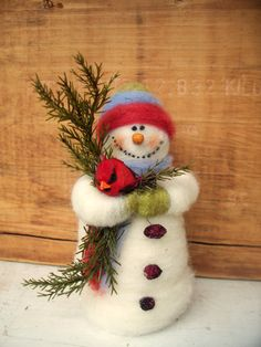 "Buddy the Snowman and Cardinal by WhimsicalWoolies on Etsy ~~ Buddy came into being 2011 and stands freely at 6"" tall. He is also strung for hanging as an ornament if you so desire. He is completely handmade  by wrapping wool over a styrofoam and wire frame. He holds a cardinal and evergreen ever so tightly."