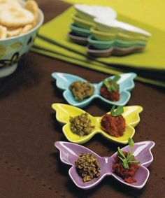 Butterfly Dish Wedding Favor Set includes 6 dishes. Each dish is made of ceramic in the shape of a butterfly. It is available in lavender, white, aqua blue, and apple green. You can use these dishes to enhance your centerpieces as a unique decorative accent.