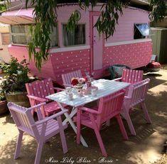 Love how the chairs match the camper ... SUPER CUTE :)