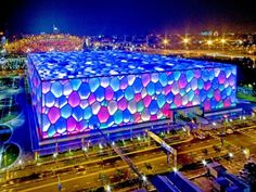 It's the Beijing National Aquatics Center in China, or the Water Cube, which was built in preparation for the 2008 Olympics. Among the major Olympic venues, only the Water Cube has had a productive afterlife. Olympic Venues, Happy Magic, Water Facts, Beijing Olympics, Peking, Space Frame, National Stadium, Sport Hall, Sports Complex
