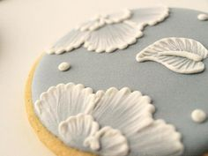 """6 Orange Vanilla Spice Cookies in dusty blue with """"embroidered"""" Royal Icing flowers. SweetAmbs your cookies are gorgeous!"""