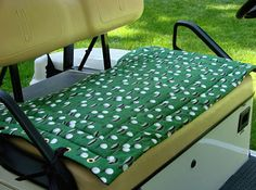A golf cart seat cover that easily transfers from golf cart to golf cart. This golf cart seat cover is created from high-quality, washable fabrics, which are lightly quilted to end the discomfort of cold vinyl seats in winter and hot seats in summer. The seat cover is reversible and will not slip, slide or fall off a seat, due to the grommets with ties to attach to the cart. This is a great useful gift. $35.00