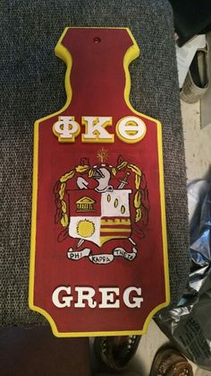 Hand painted phi kappa Theta fraternity paddle