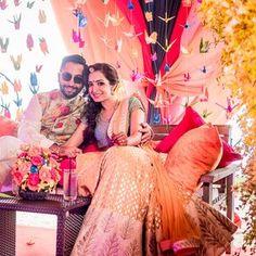 The bride and groom at the mehendi - Sabyasachi - Anita Dongre