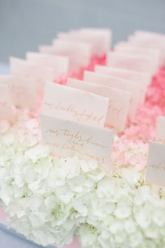 ombre hydrangeas used as a bed to hold escort cards | Photography by leilabrewsterphotography.com |  Event Design + Planning by trueevent.com |  Floral Design by stoneblossomflorals.com |   Read more - http://www.stylemepretty.com/2013/06/27/old-saybrook-connecticut-wedding-from-true-event-leila-brewster-photography/