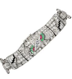 A Platinum Art Deco Egyptian Revival  multi-gem flexible bracelet consisting of Old European cut diamonds, custom cut emeralds, rubies and onyx. Circa 1925.