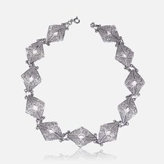 Rhombus Choker  222€   Silver 925 - Rhodium plating H. 1.84 cm 2 to 3 weeks from purchase Available in gold, email us for more information  Handmade with love