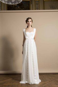 The way the straps on this dress weirdly yet elegantly look like suspenders. | 50 Gorgeous Wedding Dress Details That Are Utterly To Die For