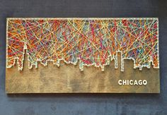 Custom-made city skyline string art with wooden lettering. Not your city? No…