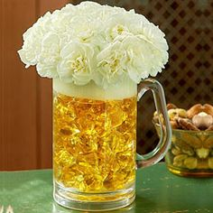 Toast for Every Occasion!!  This selection containing carnations and an acrylic beer mug is a fascinating delight for all occasion!  The color of the carnation is enhanced by the darker shade of the beer in the clear mug. Distinct in its own way, this creation is just what we call a right mix of excitement and pleasure!!  You would get them in three variants- small,medium and large.