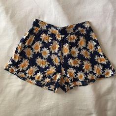 Daisy Shorts High-waisted flowy daisy shorts. Navy blue with white and yellow daisy's all around. Shorts