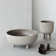 Bowls by Kristina Dam Design Studio small and medium with grey engobe on terracotta.