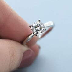 1.50ct cushion cut diamond hybrid set in a simply tapered solitaire setting. Can't go wrong!