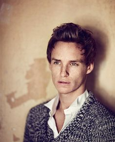 Eddie Redmayne = attractive man in sweater gazing pensively into the distance = love