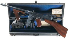 An early-production Colt Model 1921 .45ACP Thompson submachine gun (with a fitted Cutt's compensator) in an original FBI case