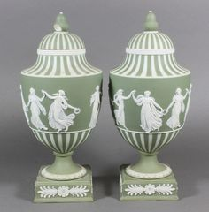 """A pair of 19th Century Wedgwood green Jasperware urns and covers decorated classical figures 10""""."""