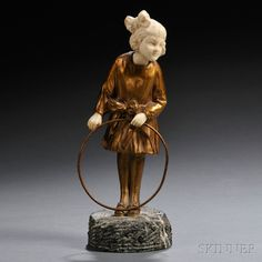 After Joseph d'Aste (French, 1905-1935) Gilt-bronze and Ivory Figure of a Girl with a Hoop | Sale Number 2645B, Lot Number 682 | Skinner Auctioneers