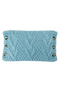 ...super cute turquoise knit pillow with button details.