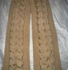 This Seed Stitch Cable Knit Scarf will keep you looking chic this winter. This gorgeous pattern shows you how to knit a scarf with thick cables running the length of it. The combination of the classic seed stitch and cable knitting gives this scarf a