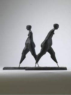 'Walking' by English sculptor Anthony Abrahams (b.1926). Bronze, edition of 9,  20.3 in high. via artnet