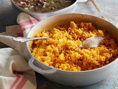 Yellow Rice: Adding onions, bell peppers and ground annatto seed to long-grain rice means this side dish will have enough flavor to hold its own against black beans.
