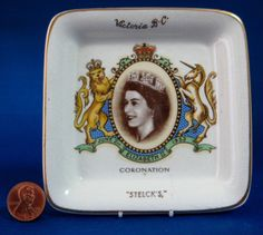 This is a neat Lancaster and Sandland, England butter pat or butter dish that was made for the coronation in 1953 of Queen Elizabeth II. The 4 inch square butter pat has a sepia photograph of the quee