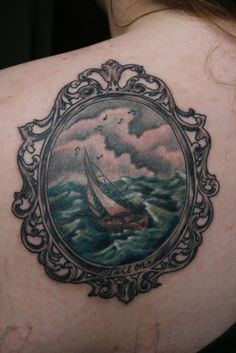 Done by Jason Stein @ Cyclops Tattoo, San Francisco, CA  This is my first tattoo. The whole thing represents my strength. I have been through a lot in my life so far and I have never given up and I know I won't either. The sailboat represents myself, the storm clouds and crazy waters represent the hardships in my life, and the music notes represent my future in music.  Submitted by awmj