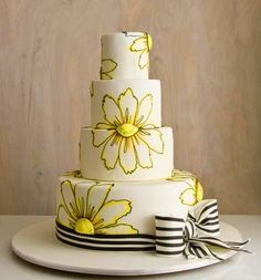 Amazing three tier white wedding cake with gorgeous hand painted yellow flowers from thecakegirls.com. I really love the black and white pinstripe ribbon ...