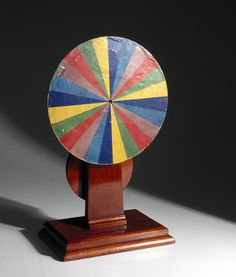 Newton's colour disc apparatus - recreated late 19th century. Spun quickly, spectrum merges, appears white